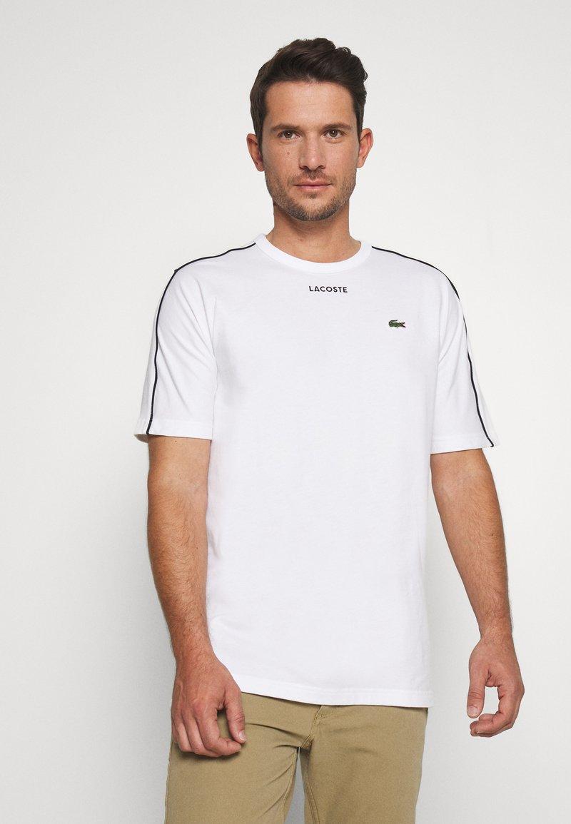 Lacoste - Print T-shirt - weiss