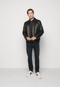 Michael Kors - LOGO ZIP - Polo shirt - black - 1