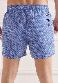 Superdry - STUDIOS - Swimming shorts - wavy line cobalt - 1