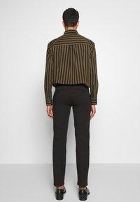 Bruuns Bazaar - DENNIS JOHANSEN PANT - Chinos - black - 2