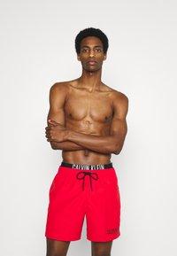 Calvin Klein Swimwear - INTENSE POWER MEDIUM DOUBLE - Swimming shorts - fierce red - 0