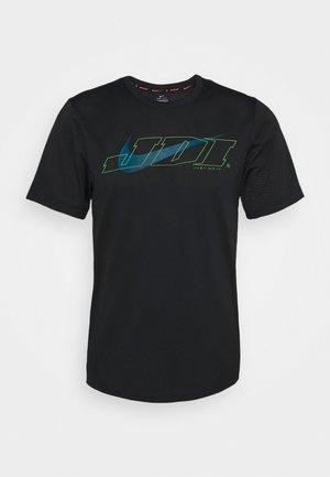 T-shirt med print - black/green abyss