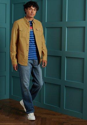 HERITAGE - Straight leg jeans - boyce worn blue