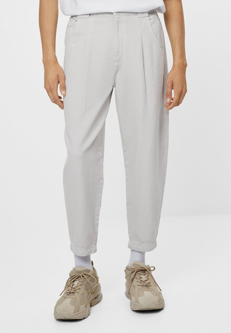 Bershka - Trousers - grey