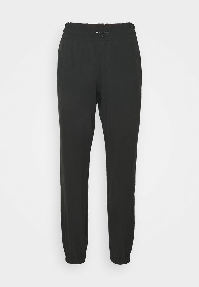 RELAXED - Teplákové kalhoty - black