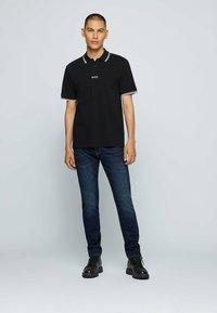 BOSS - Jeans slim fit - dark blue - 1
