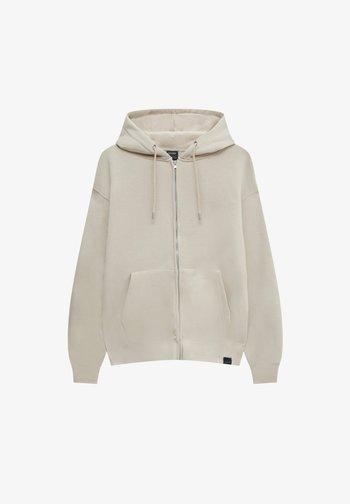 MIT REISSVERSCHLUSS UND KAPUZE - Sweater met rits - beige