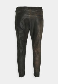 Tigha - CELSO - Leather trousers - black - 1