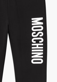 MOSCHINO - Tracksuit bottoms - black - 3