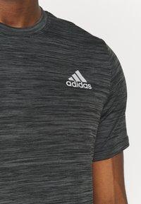 adidas Performance - OUTDOOR - T-shirt z nadrukiem - black - 3