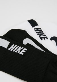 Nike Performance - 2 PACK UNISEX - Sports socks - white/black - 2