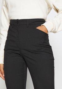 Monki - RAMONA TROUSERS - Flared Jeans - black - 3