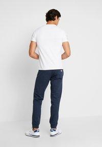 Superdry - ORANGE LABEL CLASSIC - Pantalon de survêtement - midnight blue feeder - 2