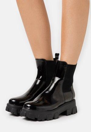 CHUNKY SOLE BOOTS - Bottines à plateau - black