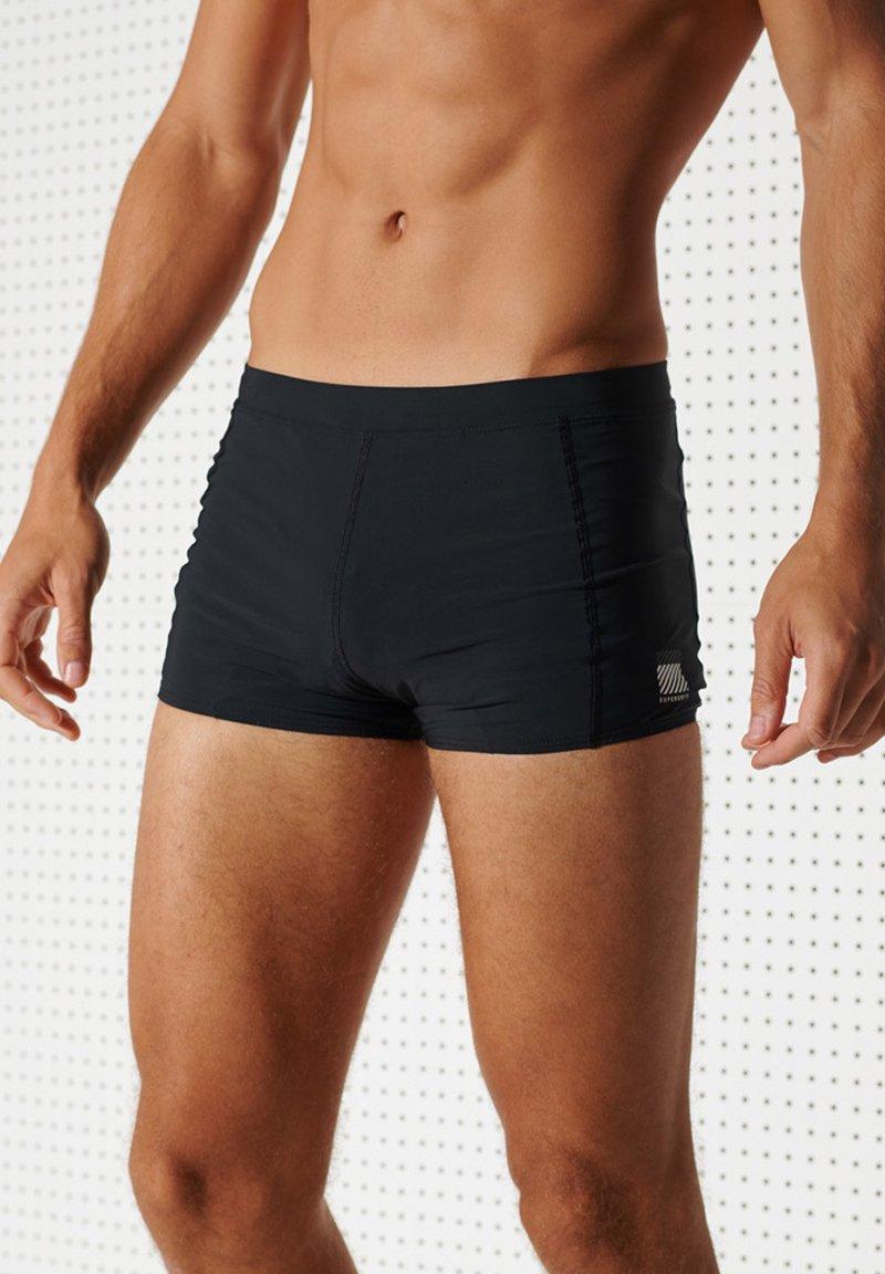 Superdry - Swimming shorts - black