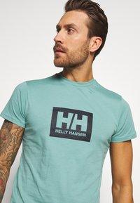 Helly Hansen - TOKYO - Print T-shirt - jade - 3