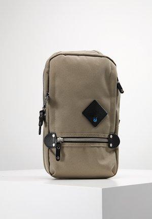 TAKAO - Across body bag - beige