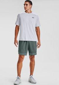 Under Armour - TRAIN STRETCH - Sports shorts - lichen blue - 1