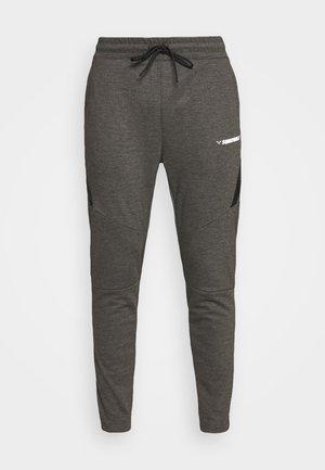 WARRIOR JOGGERS - Pantalon de survêtement - grey