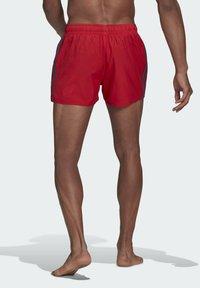 adidas Performance - CLASSIC 3-STRIPES SWIM SHORTS - Swimming shorts - red - 1