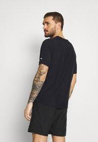Nike Performance - MILER HYBRID - Print T-shirt - black/silver - 2