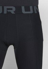 Under Armour - LEGGING - Leggings - black - 4