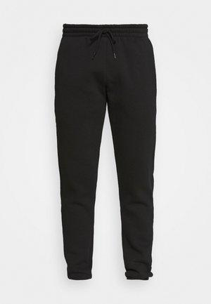 GROWEL MITU - Pantalon de survêtement - black