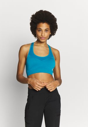 DONT SWEAT IT - Medium support sports bra - turquoise