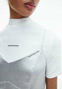 Calvin Klein Jeans - METALLIC SATIN SLIP - Cocktail dress / Party dress - silver - 3