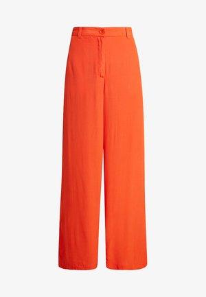 PERINUS TROUSERS - Trousers - pumpkin