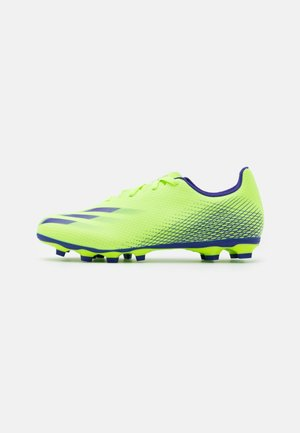X GHOSTED.4 FOOTBALL FIRM GROUND - Moulded stud football boots - signal green/energy ink