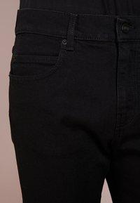 McQ Alexander McQueen - STRUMMER  - Jeans Skinny Fit - darkest black - 5