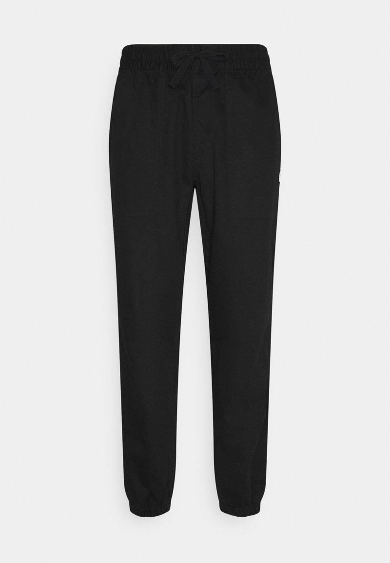 Puma - DOWNTOWN PANTS - Trousers - black