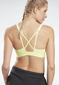 Reebok - LUX STRAPPY MEDIUM-IMPACT SPORTS BRA - Sports bra - yellow - 2