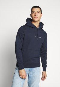 Calvin Klein - LOGO EMBROIDERY HOODIE - Hoodie - blue - 0