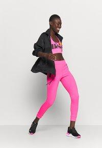 Ellesse - PRESELLE - Medium support sports bra - neon pink - 1