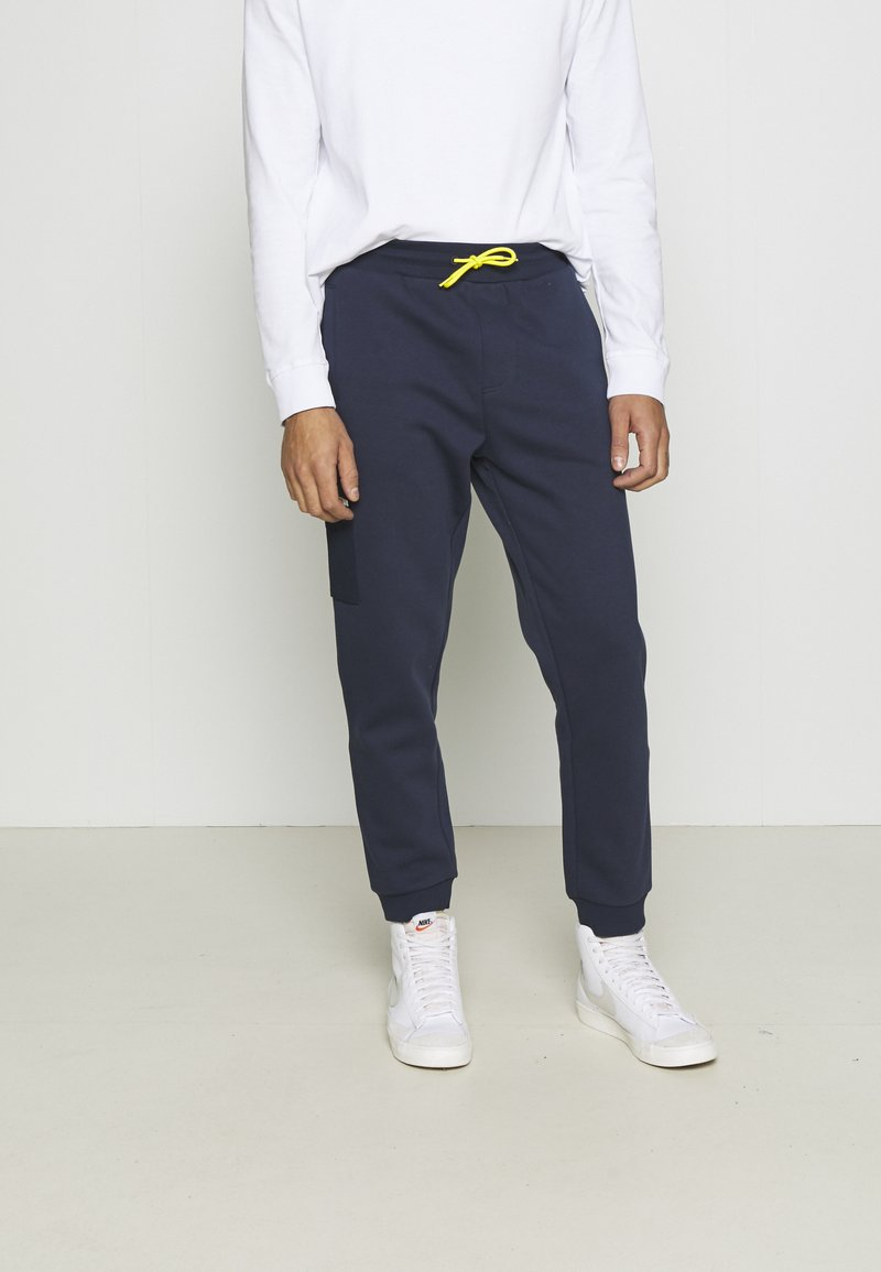 Tommy Jeans - Tracksuit bottoms - twilight navy/multi