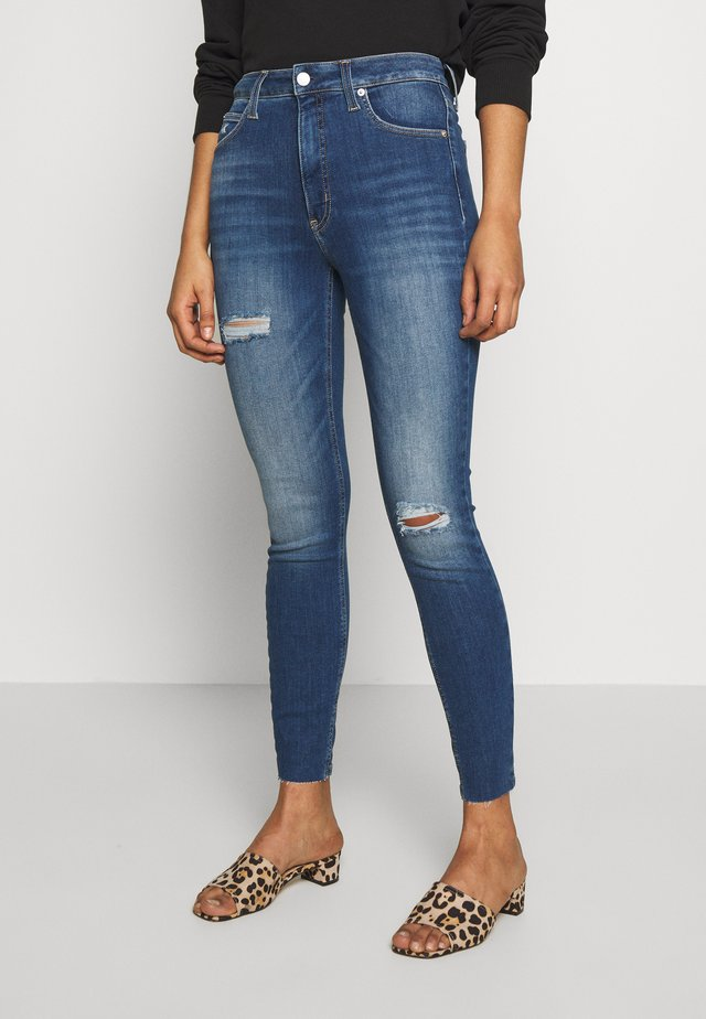 HIGH RISE SUPER ANKLE - Jeansy Skinny Fit - mid blue