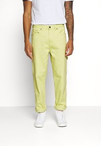 Karl Kani - PANTS  - Relaxed fit jeans - yellow - 2