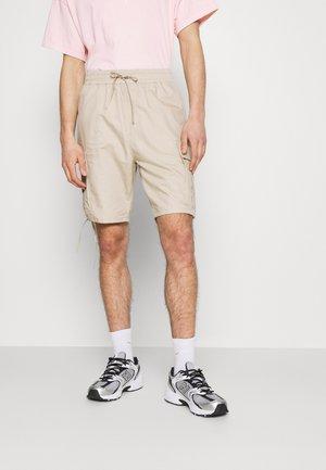 KRISTOFFER - Shorts - beige
