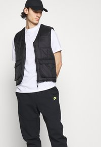 Nike Sportswear - Tracksuit bottoms - black/volt - 3