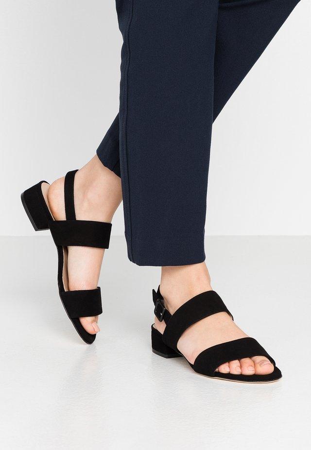 TAZZE - Sandaalit nilkkaremmillä - nero
