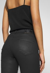 Sisley - TROUSERS - Jeans Skinny Fit - black - 3