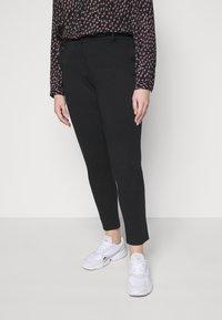 Pieces Curve - PCFIE PANTS - Trousers - black - 0