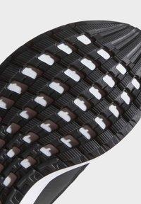 adidas Performance - RAPIDARUN UNISEX - Neutrální běžecké boty - black - 8