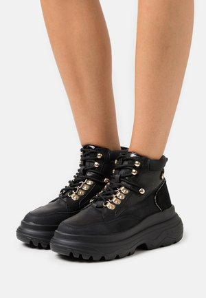 Lace-up ankle boots - black