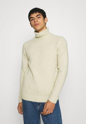 Stickad tröja - antique white melange