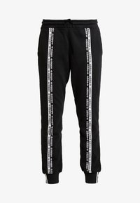 adidas Originals - R.Y.V. CUFFED SPORT PANTS - Tracksuit bottoms - black - 3