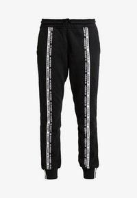 adidas Originals - R.Y.V. CUFFED SPORT PANTS - Verryttelyhousut - black - 3