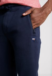 Superdry - COLLECTIVE - Tracksuit bottoms - darkest navy - 4
